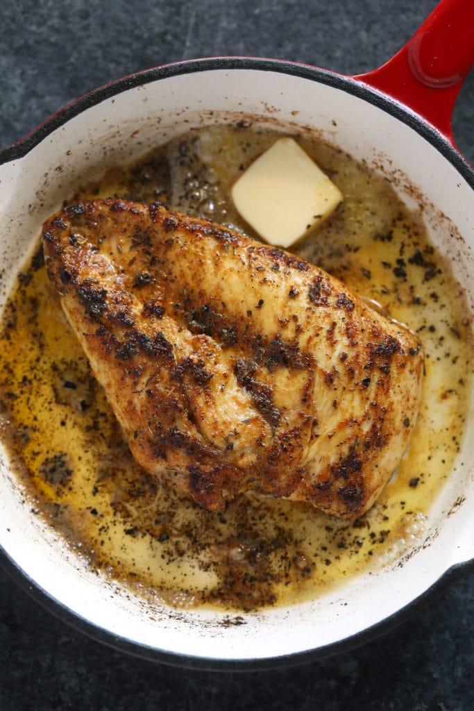 fried chicken breast in pan