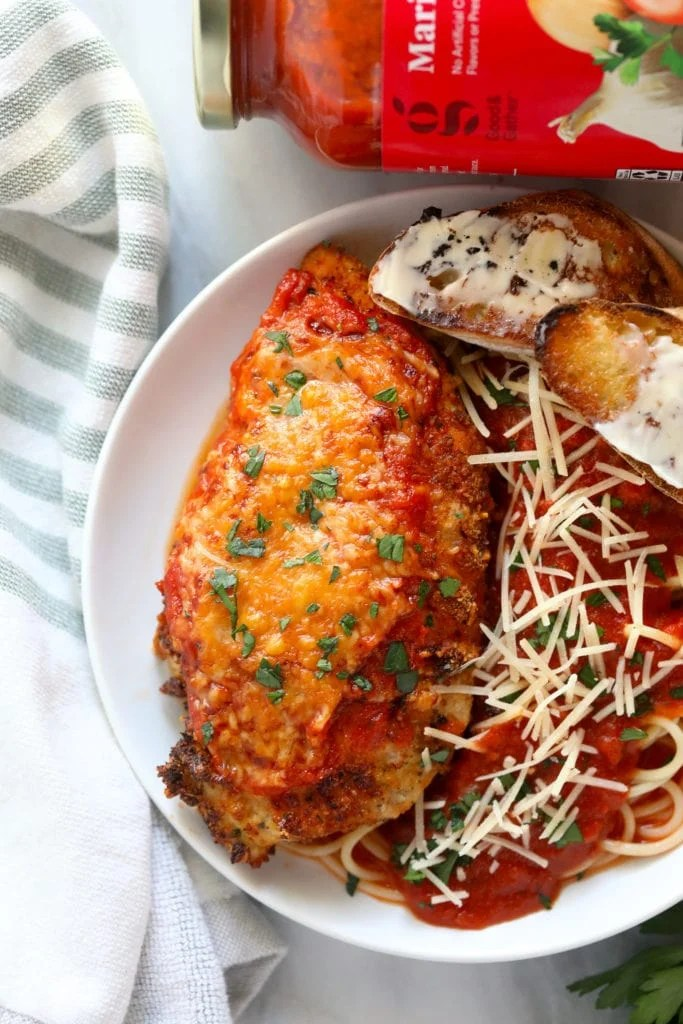 chicken parmesan on plate with pasta
