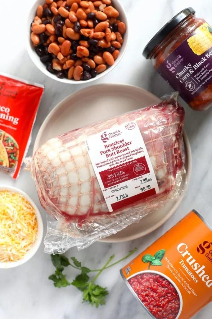 pork shoulder, taco seasoning, cheese, crushed tomatoes, salsa, and beans
