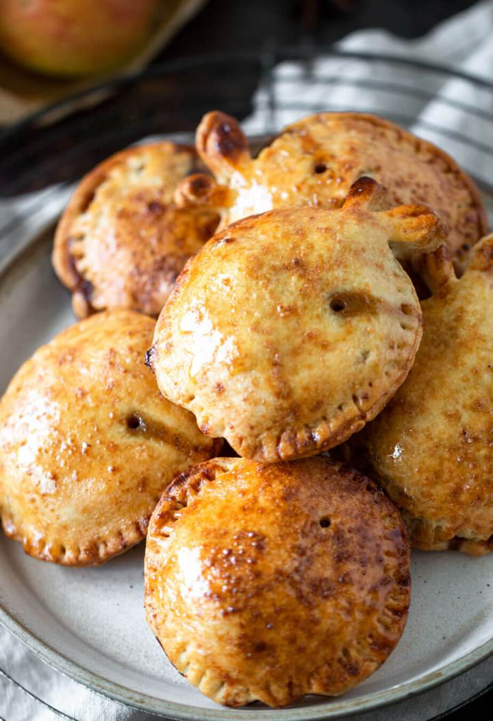 Close up view of apple hand pies on a plate
