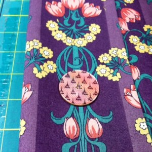 Testing the button on the art deco fabric