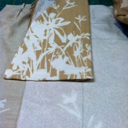 Placing the scrap on the pattern and fabric.