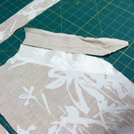 Pockets, interfacing, and facing pieces ready for construction.
