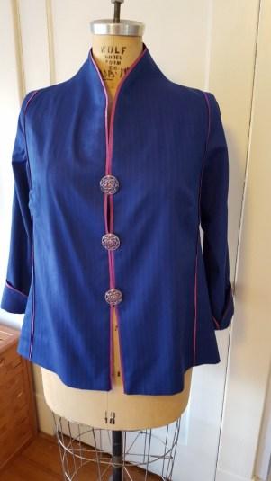 Blue silk shirt with pink trim.