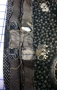 Close up of the band with button holes and center seam.