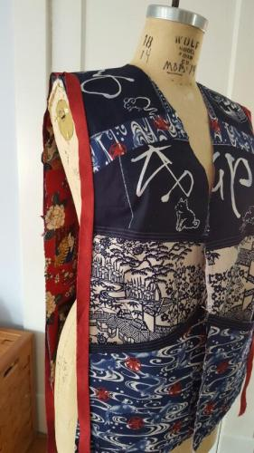 On the dressform with flat piping positioned. See the foundation peaking out underneith?