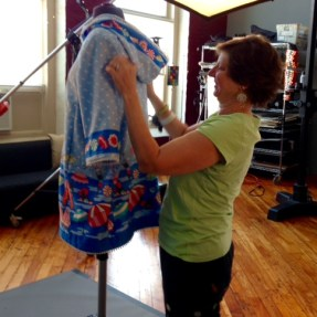 Our friend and stylist Edye adjusting the beach coat.