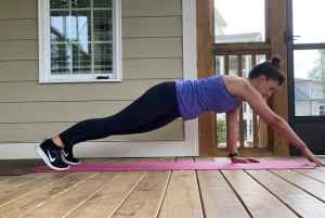 woman doing high plank reach