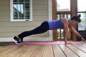woman doing plank taps