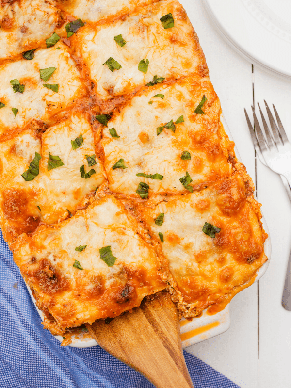 lasagna cut into portions being served