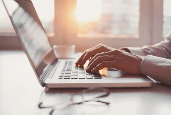 lady typing on laptop