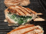 stuffed pork chops with spinach and cheese cooking on the indoor grill