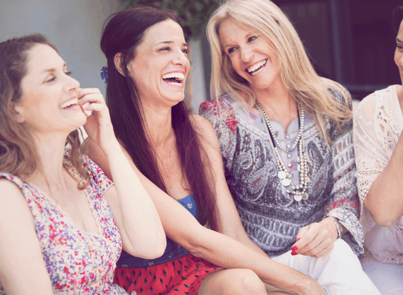 women sitting around chatting and laughing