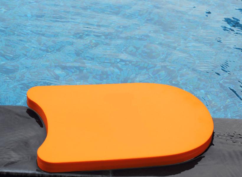 kickboard beside pool