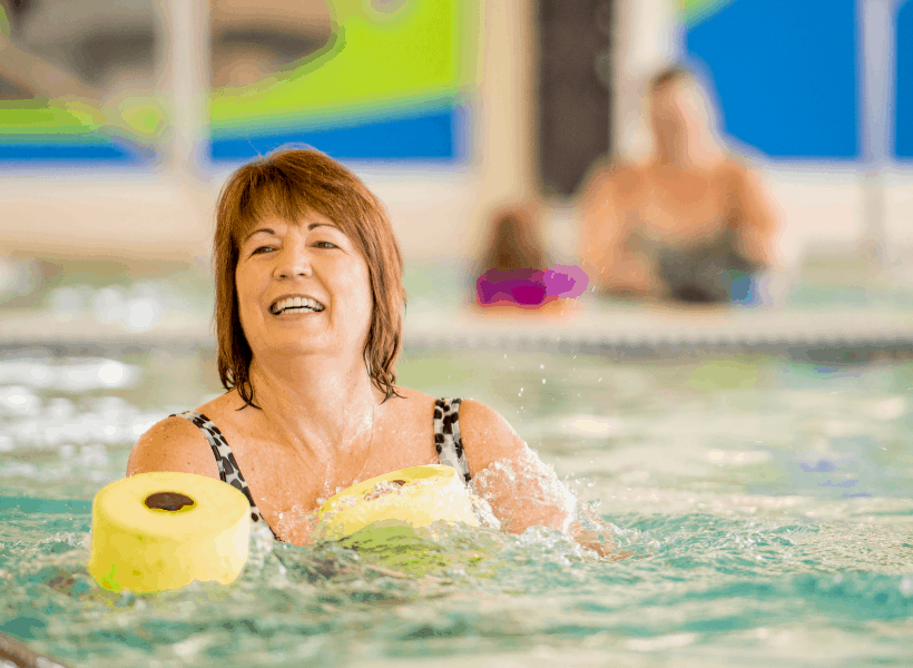 lady in pool doing low impact workouts