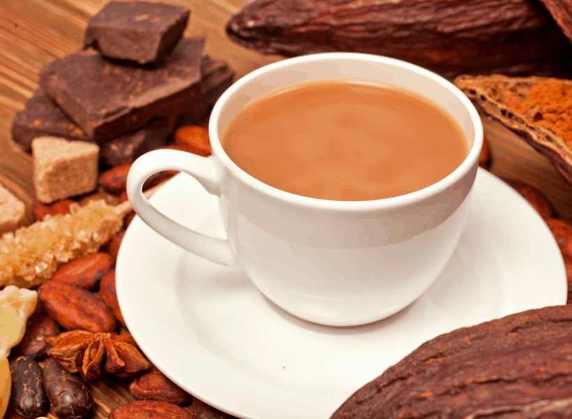 cup of coffee on a table with cacao butter