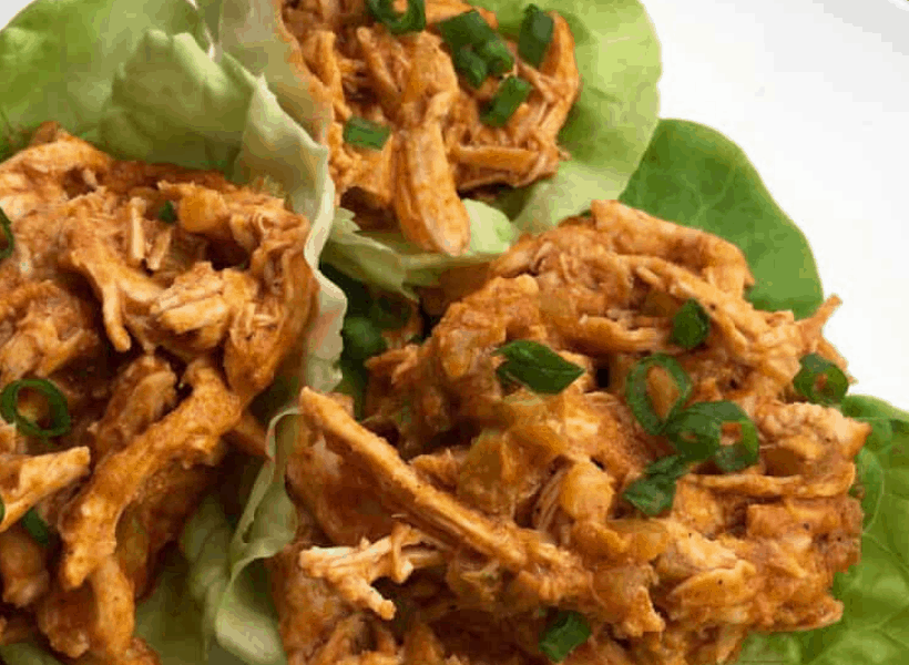 buffalo chicken in lettuce cups on a white plate