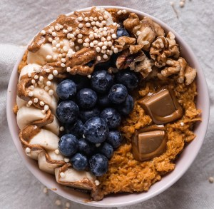 Carrot cake oatmeal with salted caramel chocolate, almond butter and fruits