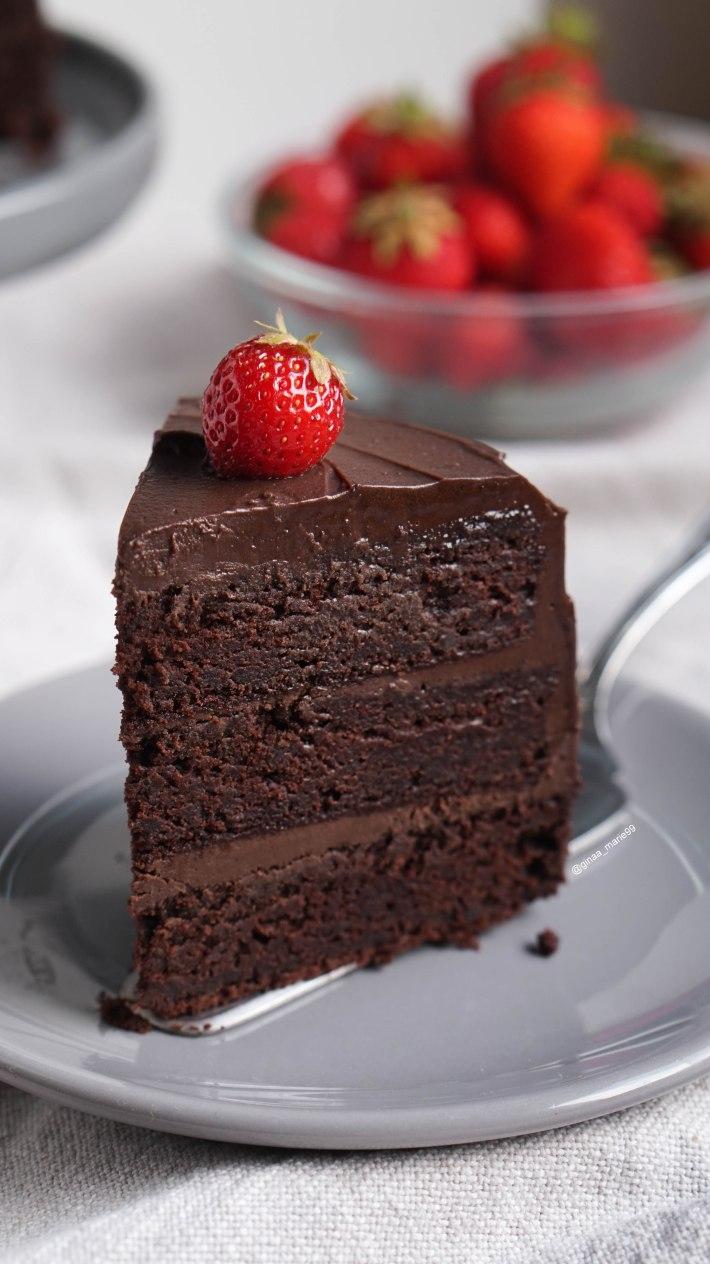 vegan layered chocolate cake with strawberries