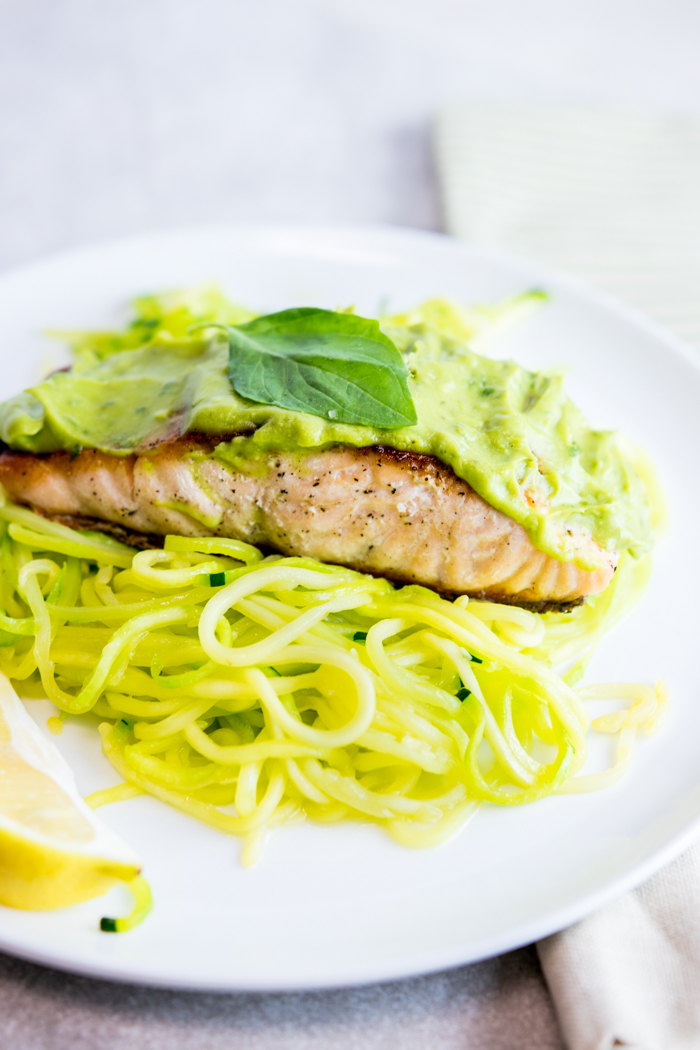 Pan Seared Salmon with Lemon Basil Avocado sauce over Zoodles