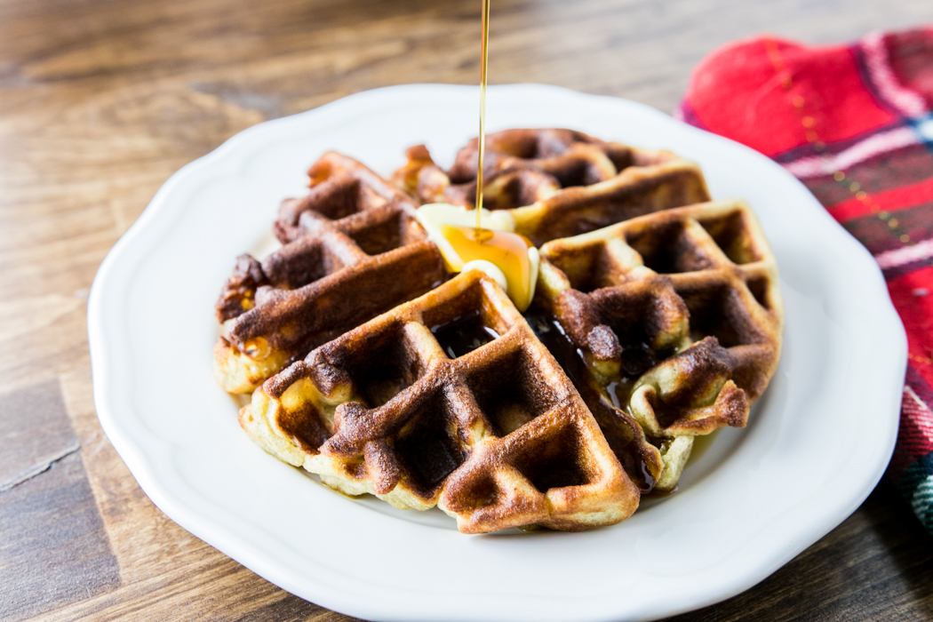 gluten free gingerbread waffles on a plate with syrup