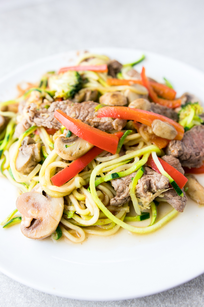 beef stir fry with zoodles close-up