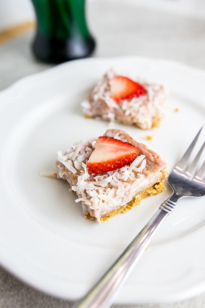 Paleo Strawberry Coconut bars on a plate with fork
