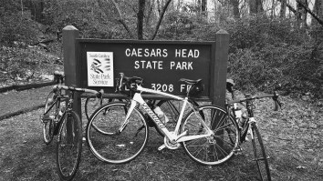 "This image shows my beloved bike, Ruby, against the sign that says ""Caesar's Head State Park, 3208 feet"""
