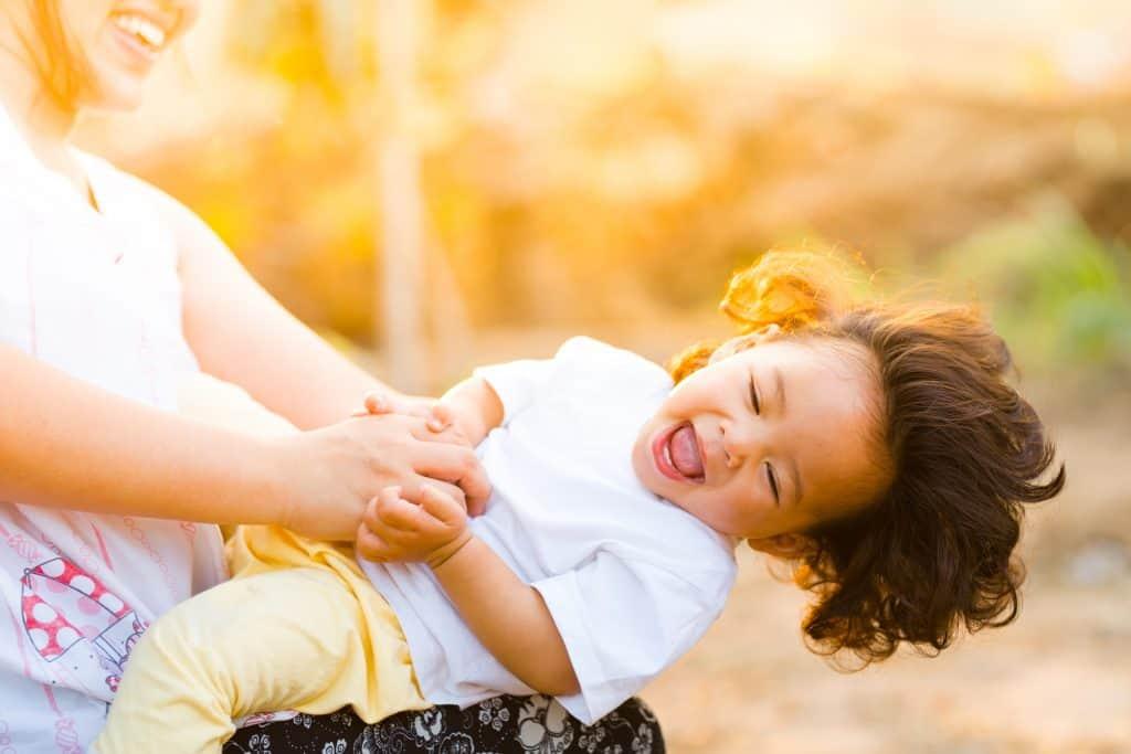 happy baby and parent