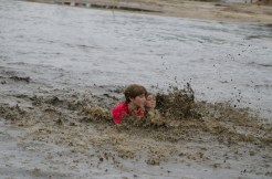 kids-splashing-in-mud-run-race