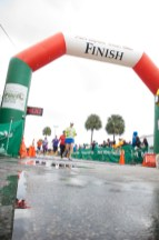 runner crossing finish line