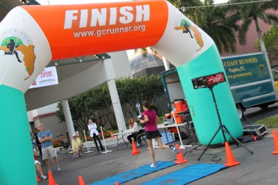 lady crossing finish line
