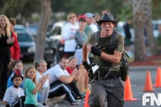 guy in cowboy hat running