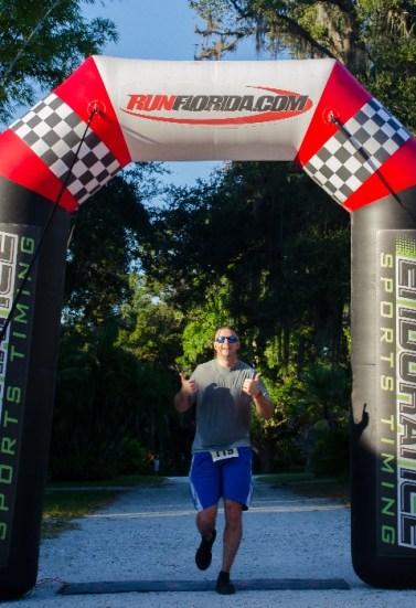 Man crossing finish line