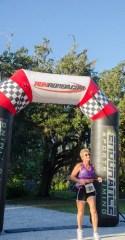 older lady crossing finish line