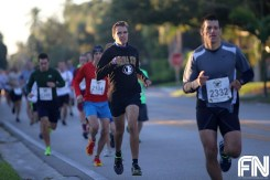 White male black fsu shirt running