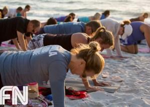 fitnation-sunset-yoga-on-the-beach