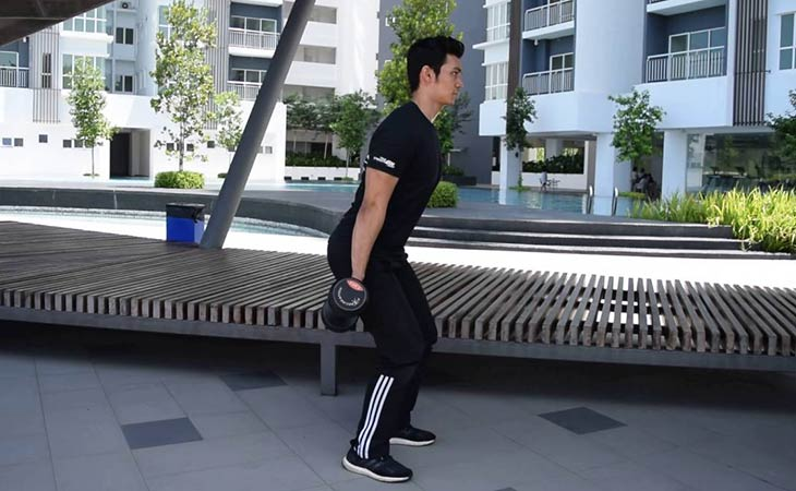 Man Working Out Dumbbell Hack Squat