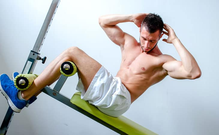 Exercising Using A Sit Up Bench