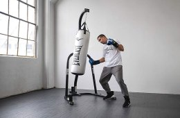 Man Boxing For Fitness Using A Boxing Stand