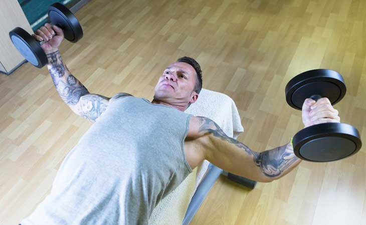 Man Working Out His Chest Dumbbell Fly Exercise
