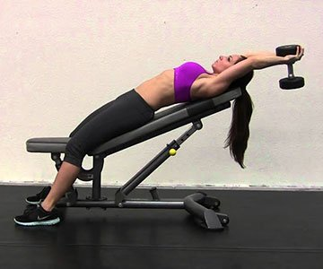 Woman Doing An Incline Dumbbell Pullover