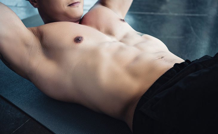 Fit Man Working Out Abs Muscle