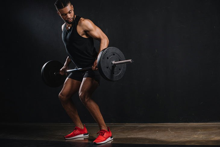 Sportsman Wearing Weightlifting Shoes For Fitness