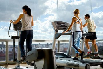 Men Women Working Out Using Treadmill and Elliptical