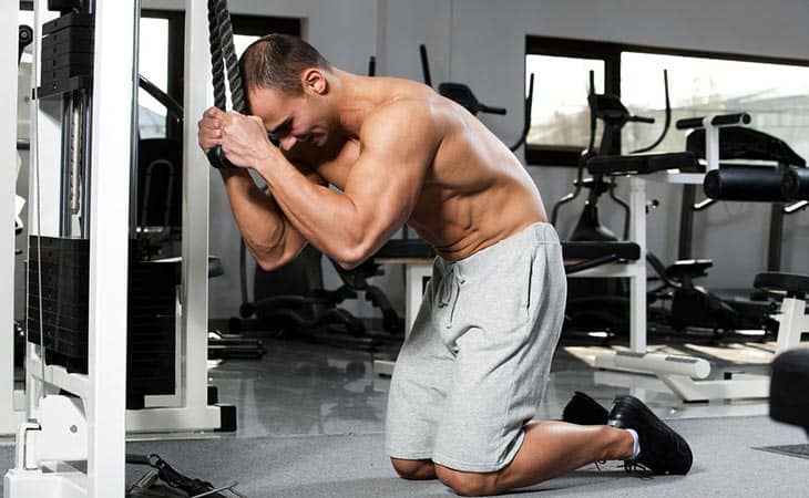 Man Working Out Weighted Crunches For Fitness