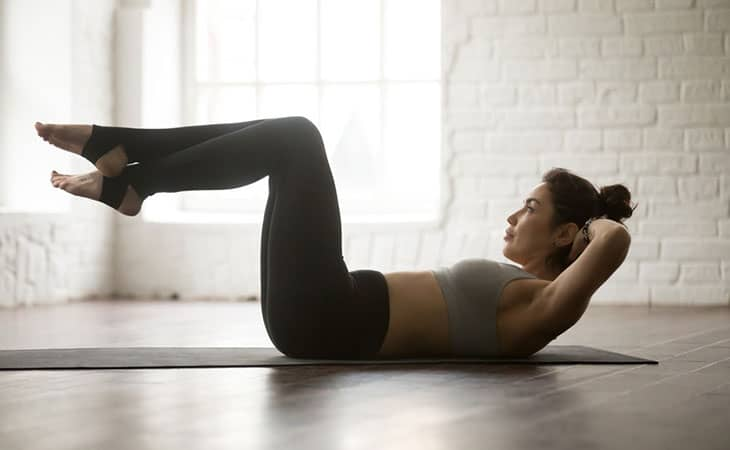 Fit Woman Working Out Knee Crunch
