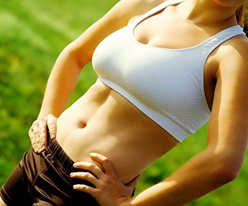 Fit Woman Showing Her Abs Muscle