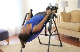 Woman Using Inversion Table For Fitness