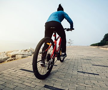 Woman Using Mountain Bike For Fitness